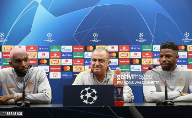 Galatasaray's Turkish head coach Fatih Terim Dutch forward Ryan Babel and Dutch defender Ryan Donk give a press conference on September 17 2019 at...