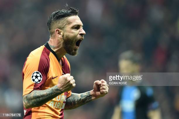 Galatasaray's Turkish midfielder Adem Buyuk celebrates after scoring a goal during the UEFA Champions League football match between Galatasaray and...