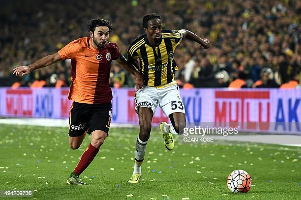 Galatasaray's Turkish midfielder Selcuk Inan vies for ball with Fenerbahce's Senegalese defender Abdoulaye Ba during the Turkish Super Lig football...