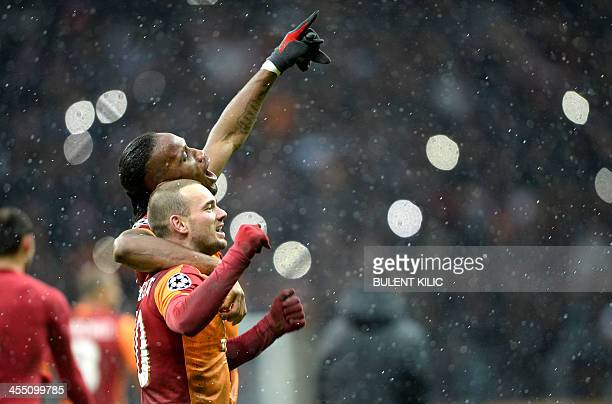 Galatasaray's Wesley Sneijder celebrates his goal with his teammate Didier Drogba during their UEFA Champions League group B football match on...