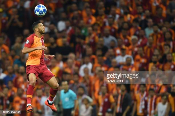 Galatasaray's Younes Belhanda heads the ball during the UEFA champions league group D football match between Galatasaray and Lokomotiv Moscow at the...