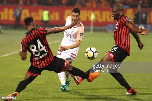 Galatasaray's Younes Belhanda vies with Genclerbirligi's Stephane Sessegnon and Florentin Pogba during the Turkish Super Lig football match between...