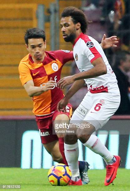 Galatasaray's Yuto Nagatomo challenges Antalyaspor's Nazim Sangare during the first half of a Turkish Super Lig match in Istanbul on Feb 12 2018...