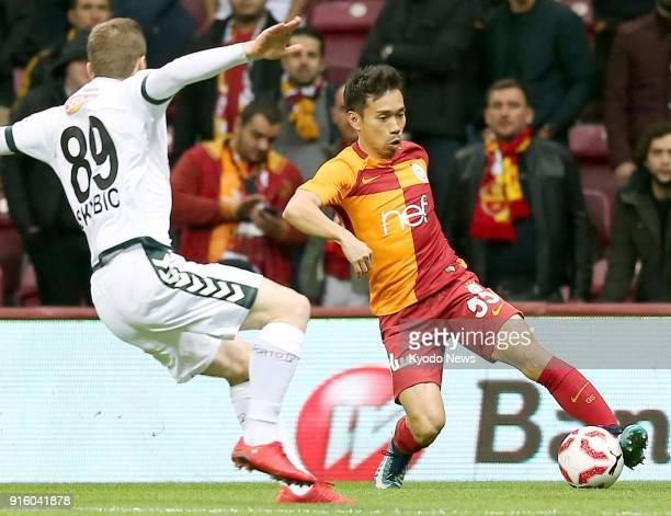 Galatasaray's Yuto Nagatomo controls the ball near Konyaspor's Nejc Skubic during the first half of a Turkish domestic cup match in Istanbul on Feb 8...