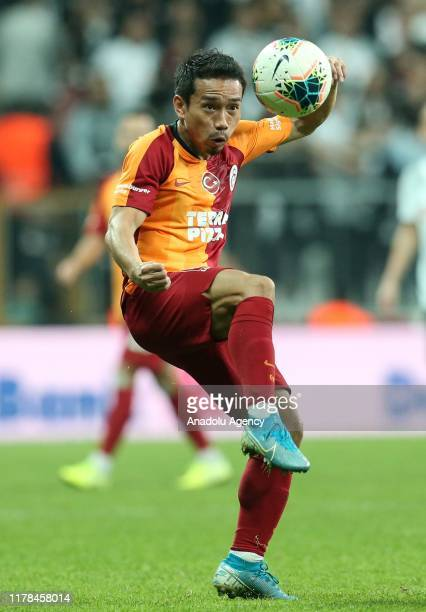 Galatasaray's Yuto Nagatomo in action during the Turkish Super Lig week 9 soccer match between Besiktas and Galatasaray at the Vodafone Park in...