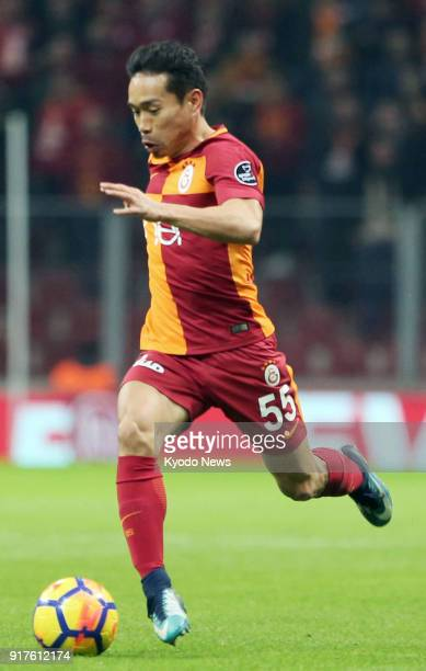 Galatasaray's Yuto Nagatomo of Japan dribbles during the first half of his team's 30 win over Antalyaspor in Turkish Super Lig in Istanbul on Feb 12...
