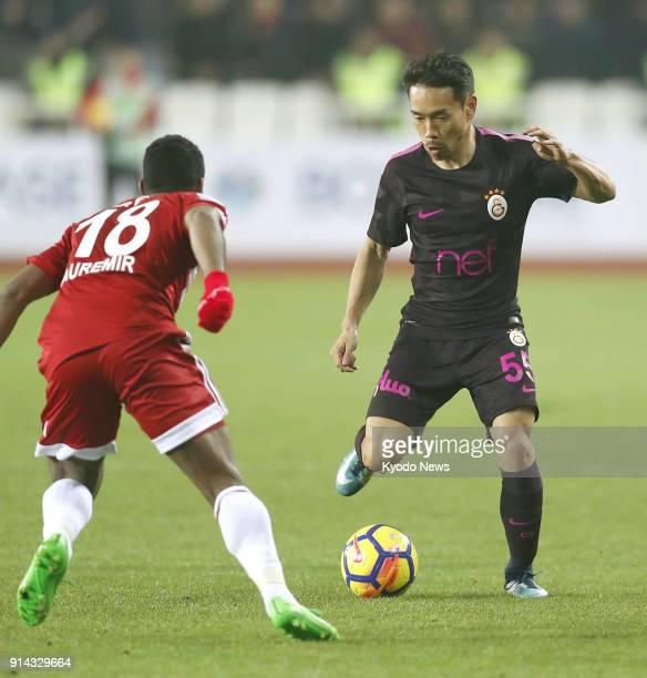 Galatasaray's Yuto Nagatomo prepares to make a pass in front of Sivasspor's Auremir during the first half of a Turkish Super Lig match in Sivas...