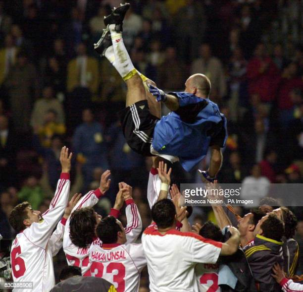 Galatasary goalkeeper Claudio Taffarel is thrown in the air after his team won the UEFA Cup against Arsenal after the penalty shootout at the Parken...