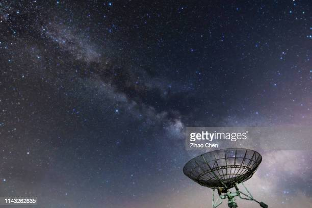 galaxy above the telescope - satellite dish stock pictures, royalty-free photos & images