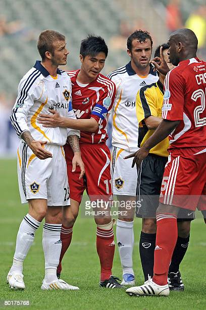 LA Galaxy football player David Beckham of Britain argues with South China's Alves Pereira Christiano during their friendly match at Hong Kong...