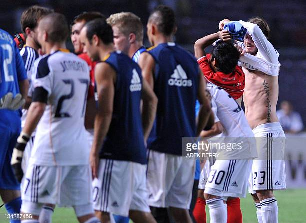 LA Galaxy football star David Beckham exchanges his jersey with Andik Vermansyah of Indonesia after an exhibition match against the Indonesia...