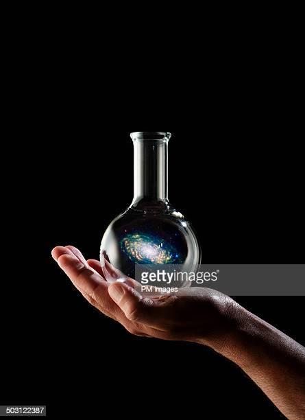 galaxy in a flask - フラスコ ストックフォトと画像