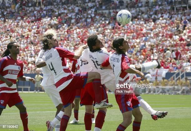 Galaxy midfielder Alvaro Pires tries to head the ball into the goal defended by FC Dallas defender Duilio Davino and midfielder Pablo Ricchetti on...