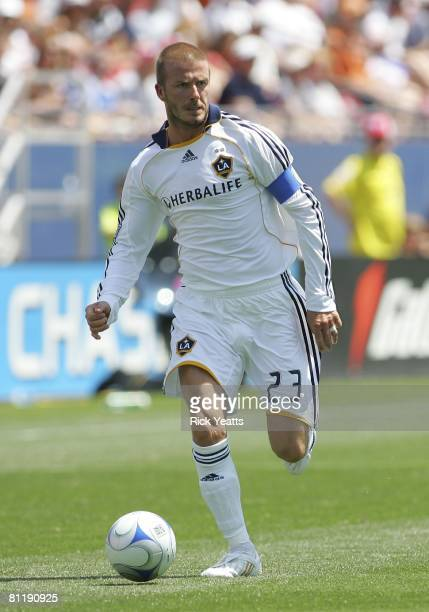 Galaxy midfielder David Beckham dribbles the ball down field against FC Dallas on May 18, 2008 at Pizza Hut Park in Frisco, Texas. The Galaxy...