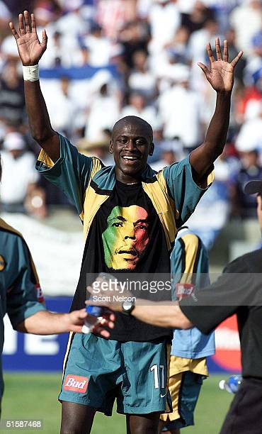 Galaxy midfielder Ezra Hendrickson shows off his Bob Marley t-shirt as he celebrates 21 January 2001 after defeating Honduran squad CD Olimpia by a...