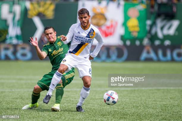 Galaxy midfielder Jonathan dos Santos controls a ball marked by Portland Timbers midfielder David Guzmán during the Portland Timbers 31 victory over...