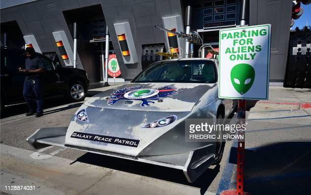 A 'Galaxy Peace Patrol' takes up a parking slot marked 'Parking for Aliens Only' in the town of Baker California which claims the world's largest...