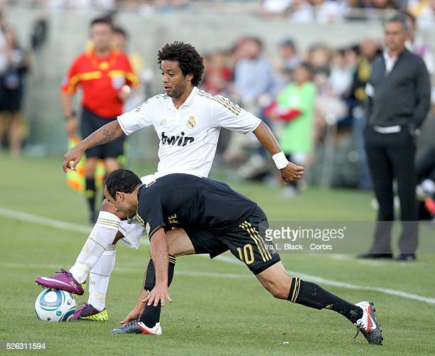 LA Galaxy player Landon Donovan tries to stop Real Madrid's Marcelo during the Herbalife World Football Challenge Friendly match between LA Galaxy...