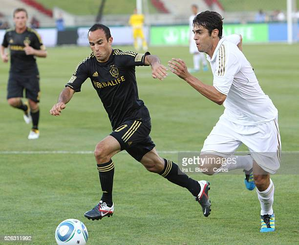 LA Galaxy player Landon Donovan tries to stop the run by Real Madrid's Kaka during the Herbalife World Football Challenge Friendly match between LA...
