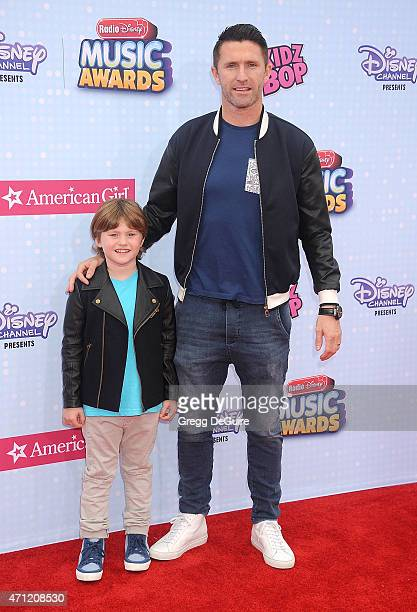 A Galaxy player Robbie Keane and son Robert Ronan Keane arrive at the 2015 Radio Disney Music Awards at Nokia Theatre LA Live on April 25 2015 in Los...