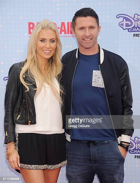 A Galaxy player Robbie Keane and wife Claudine Palmer arrive at the 2015 Radio Disney Music Awards at Nokia Theatre LA Live on April 25 2015 in Los...