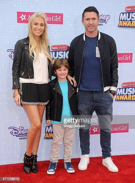 A Galaxy player Robbie Keane wife Claudine Palmer and son Robert Ronan Keane arrive at the 2015 Radio Disney Music Awards at Nokia Theatre LA Live on...