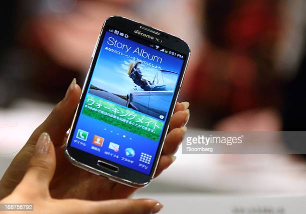 Galaxy S4 smartphone manufactured by Samsung Electronics Co. Is displayed during the unveiling of NTT DoCoMo Inc. New smartphones in Tokyo, Japan, on...