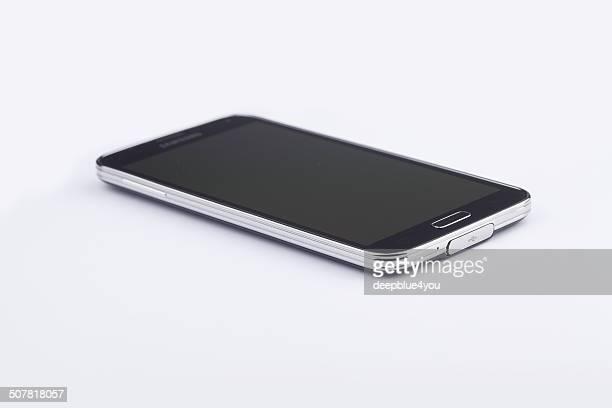 Galaxy S5 smartphone flat lying on white background