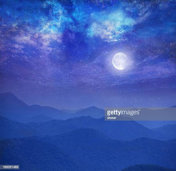 Galaxy with moon in mountains