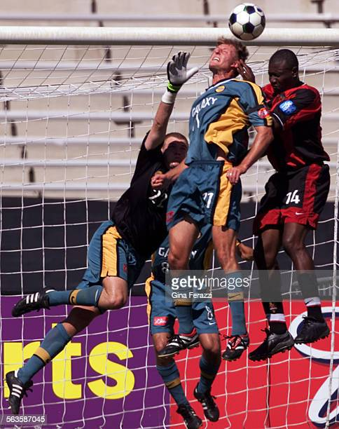 Galaxy's Sasha Victorine heads the ball away from New Jersey Adolfo Valencia in front of Galaxy golie Kevin Hartman in the second half at the Rose...