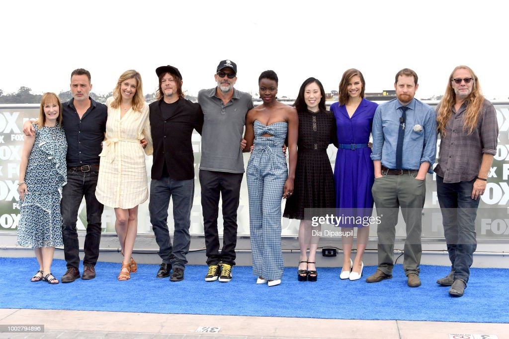Gale Ann Hurd, Andrew Lincoln, Denise M. Huth, Norman Reedus, Jeffrey Dean Morgan, Danai Gurira, Angela Kang, Lauren Cohan, Scott M. Gimple and Greg Nicotero attend 'The Walking Dead' Photo Call during Comic-Con International 2018 at Andaz San Diego on July 20, 2018 in San Diego, California.