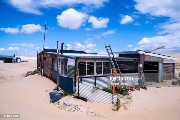 Gale force winds battered Tin City and Stockton beach sand dunes The shacks were built during the great depression of the 1930s by a group of...