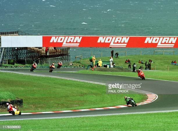 Gale force winds create whitehorses on the Bass Strait sea during the first qualifying session of the Australian 250cc Motorcycle Grand Prix on...