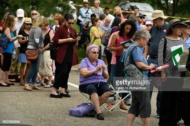 Gale Martin knits while she waits in line for the doors to open at the gymnasium at Colorado Christian University to take part in a Town Hall meeting...