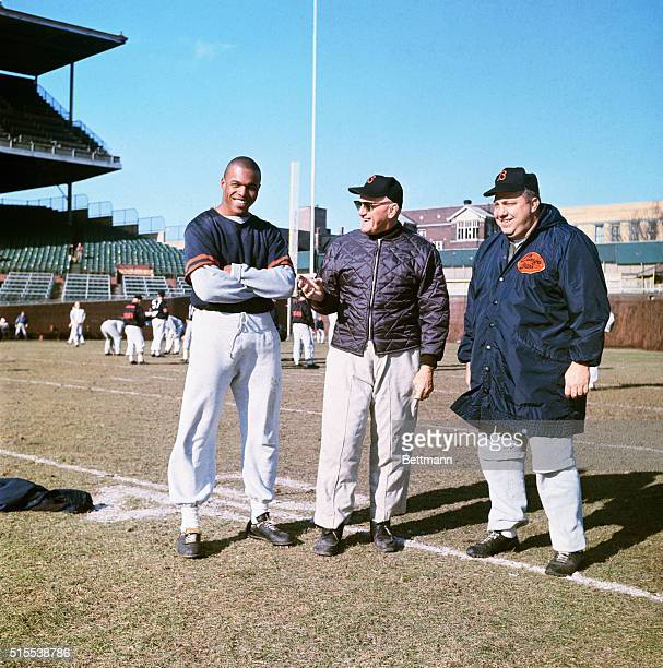 Gale Sayers Chicago Bears with coaches George Halas and Abe Gibron on practice field