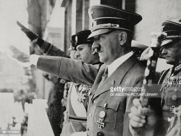 Galeazzo Ciano and Adolf Hitler saluting the crowd from the Palace of the Chancellery in Berlin after signing the Pact of Steel between Germany and...