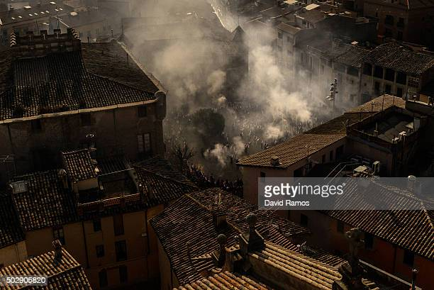'Galejadors' fire their muskets around the selected pine as they walk down the streets of Centelles during 'La Festa del Pi' in the village of...