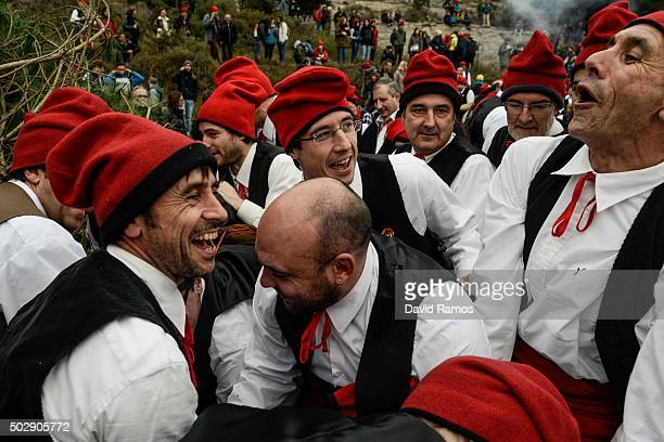 'Galejadors' gather around the selected pine after being choped down during 'La Festa del Pi' in the village of Centelles on December 30 2015 in...