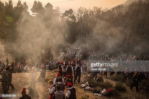 'Galejadors' gather in the forest as they have breakfast during 'La Festa del Pi' in the village of Centelles on December 30 2015 in Barcelona Spain...