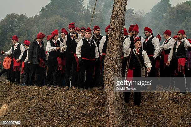 'Galejadors' gather next to the selected pine during 'La Festa del Pi' in the village of Centelles on December 30 2015 in Barcelona Spain Early in...