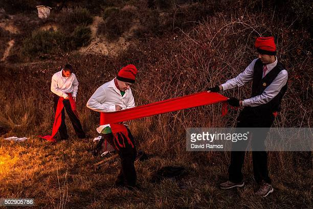 'Galejadors' get dressed during 'La Festa del Pi' in the village of Centelles on December 30 2015 in Barcelona Spain Early in the morning men and...