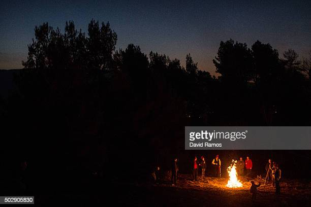 'Galejadors' light bonfires in the forest during 'La Festa del Pi' in the village of Centelles on December 30 2015 in Barcelona Spain Early in the...