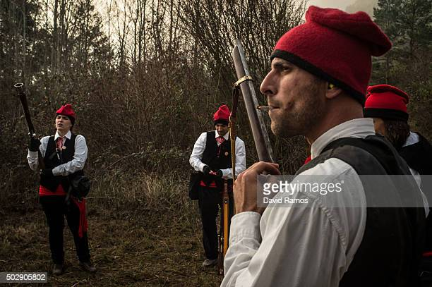 'Galejadors' load their muskets during 'La Festa del Pi' in the village of Centelles on December 30 2015 in Barcelona Spain Early in the morning men...