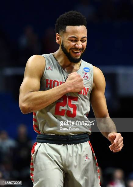 Galen Robinson Jr. #25 of the Houston Cougars celebrates defeating the Ohio State Buckeyes 74-59 in the second round game of the 2019 NCAA Men's...