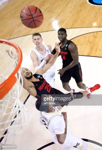 Galen Robinson Jr #25 of the Houston Cougars drives to the basket against the Michigan Wolverines during the second round of the 2018 NCAA Men's...
