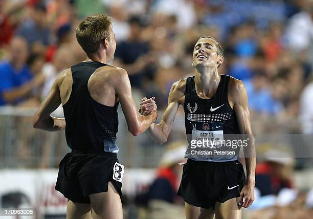 Galen Rupp and Dathan Ritzenhein shake hands after finishing first and second in the Men's 5000 Meter on day one of the 2013 USA Outdoor Track Field...