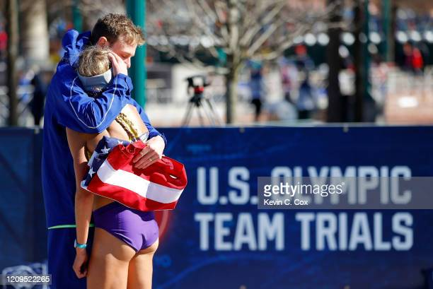 Galen Rupp consoles Jordan Hasay after she finished the Women's U.S. Olympic marathon team trials on February 29, 2020 in Atlanta, Georgia.
