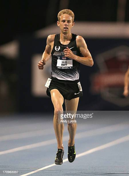Galen Rupp crosses the finish line to win the Mens'10,000 Meter on day one of the 2013 USA Outdoor Track & Field Championships at Drake Stadium on...