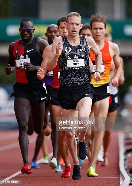 Galen Rupp leads the pack as they compete in the Men's 5000 Meter Run final during day four of the 2015 USA Outdoor Track Field Championships at...