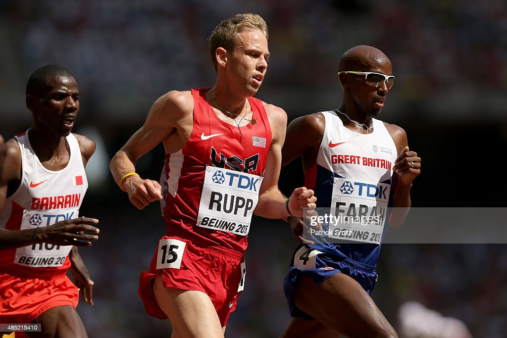 Galen Rupp of the United States and Mohamed Farah of Great Britain compete in the Men's 5000 metres heats during day five of the 15th IAAF World Athletics Championships Beijing 2015 at Beijing National Stadium on August 26, 2015 in Beijing, China.